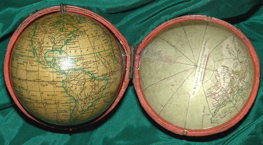 """Pocket Globe. CARY, J  [London, 1791]  Cary's Pocket Globe Agreeable to the latest Discoveries. London ... 1791 . 3 inches in diameter. In black, shagreen covered case with two brass clasps, lined with """"A Table of Latitude & Longitude of Places not given on this Globe"""" and """"The World as known in Caesar's Time agreeable to D'Anville."""" Fine original color; expansion crack in case, globe in excellent condition."""