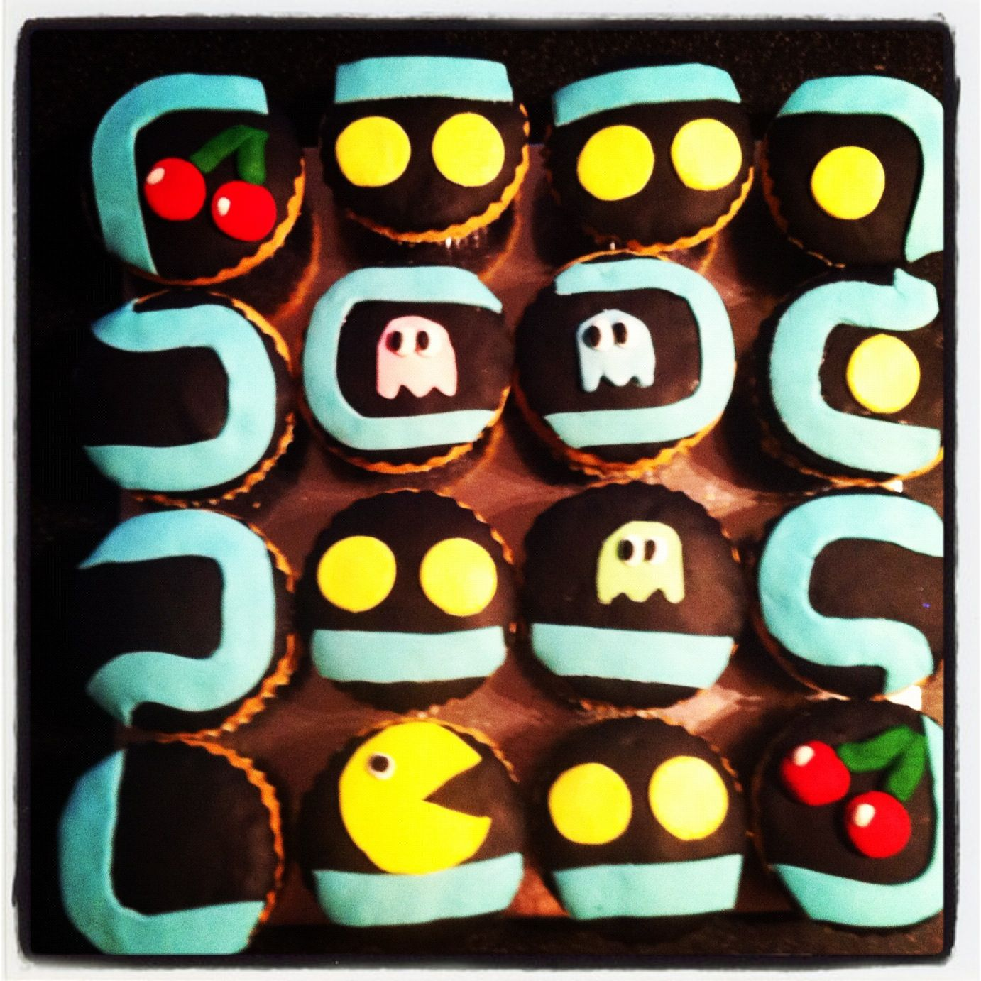 Pacman 80s style cupcakes made for a birthday.