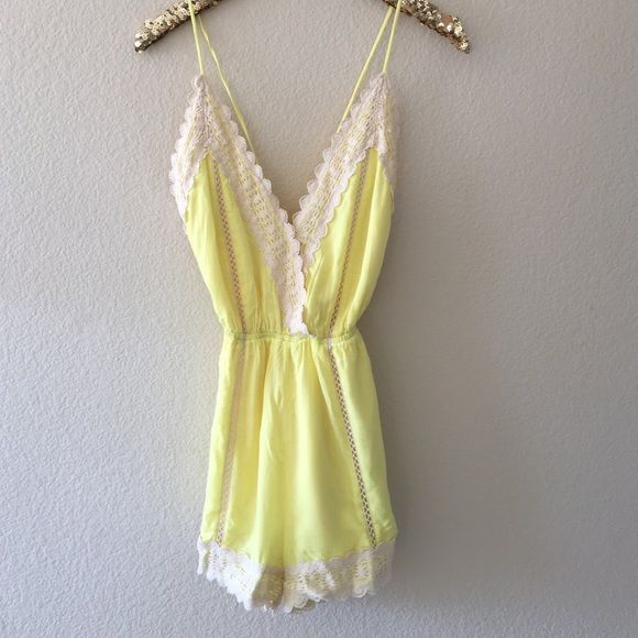 NWOT☀️Sunshine backless romper The perfect brunch outfit  Deep v neckline with crochet trim and a snap closure. The open back is adjustable. 100% polyester. Wish this fit me but its a size medium I would say it would fit a small or medium perfectly but not XS. I'm open negotiations and bundles. not branded just for visibility PINK Victoria's Secret Dresses