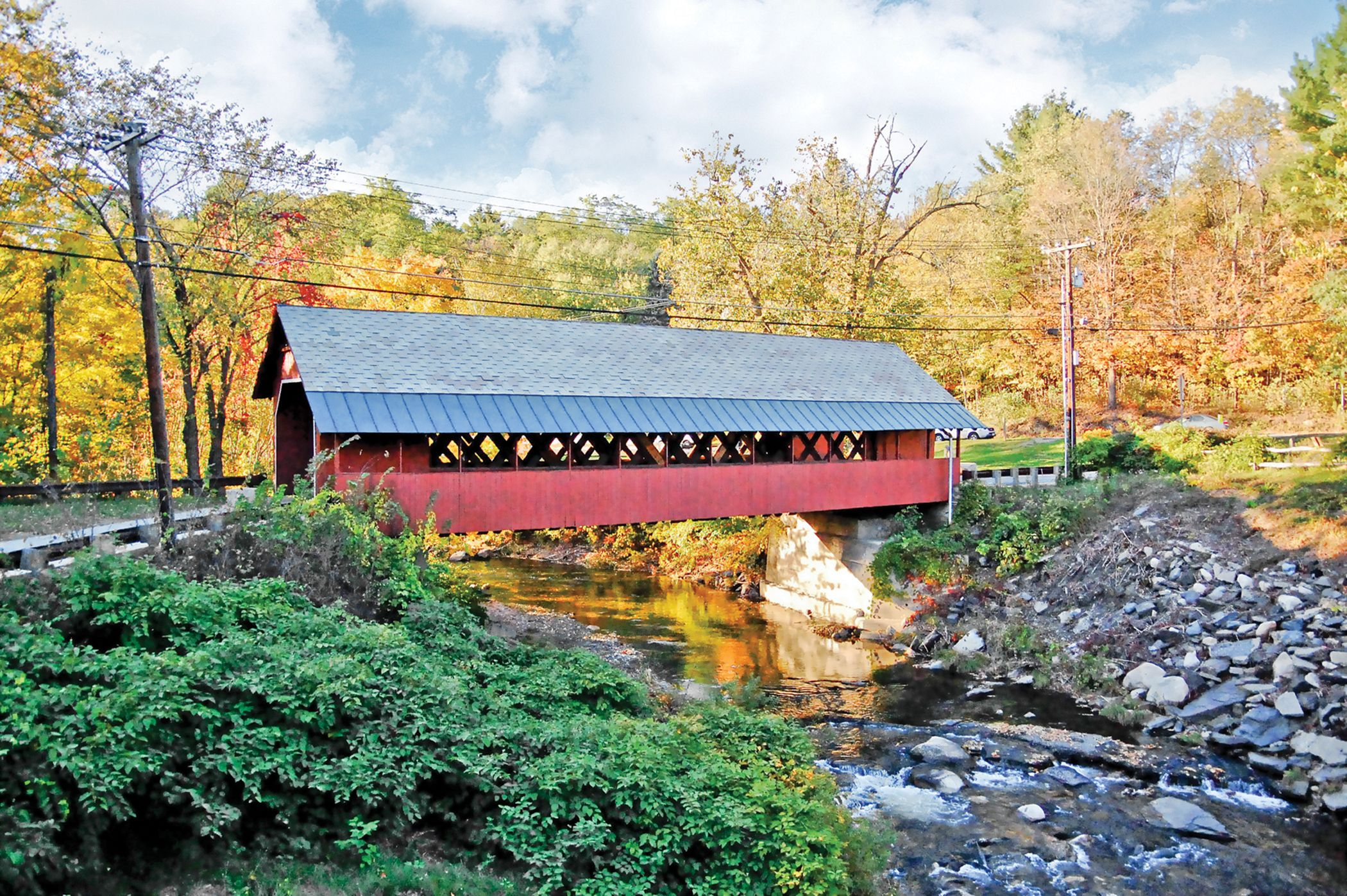 Crossing a covered bridge Colors of New England tour