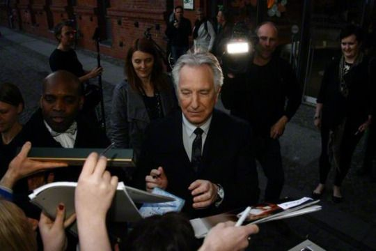 April 22, 2015 - Alan Rickman (with Rima in the background) at the German premiere of A Little Chaos in Berlin. Copyright © Retna