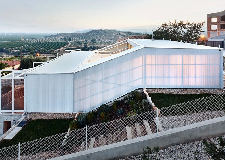 Plastic-clad house by Casos de Casas designed to suit all the seasons