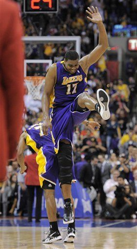 Los Angeles Lakers Center Andrew Bynum 17 Celebrates With Teammate Ramon Sessions During The Second Half Of Their Nba B Sports Lakers Win Nba Basketball Game