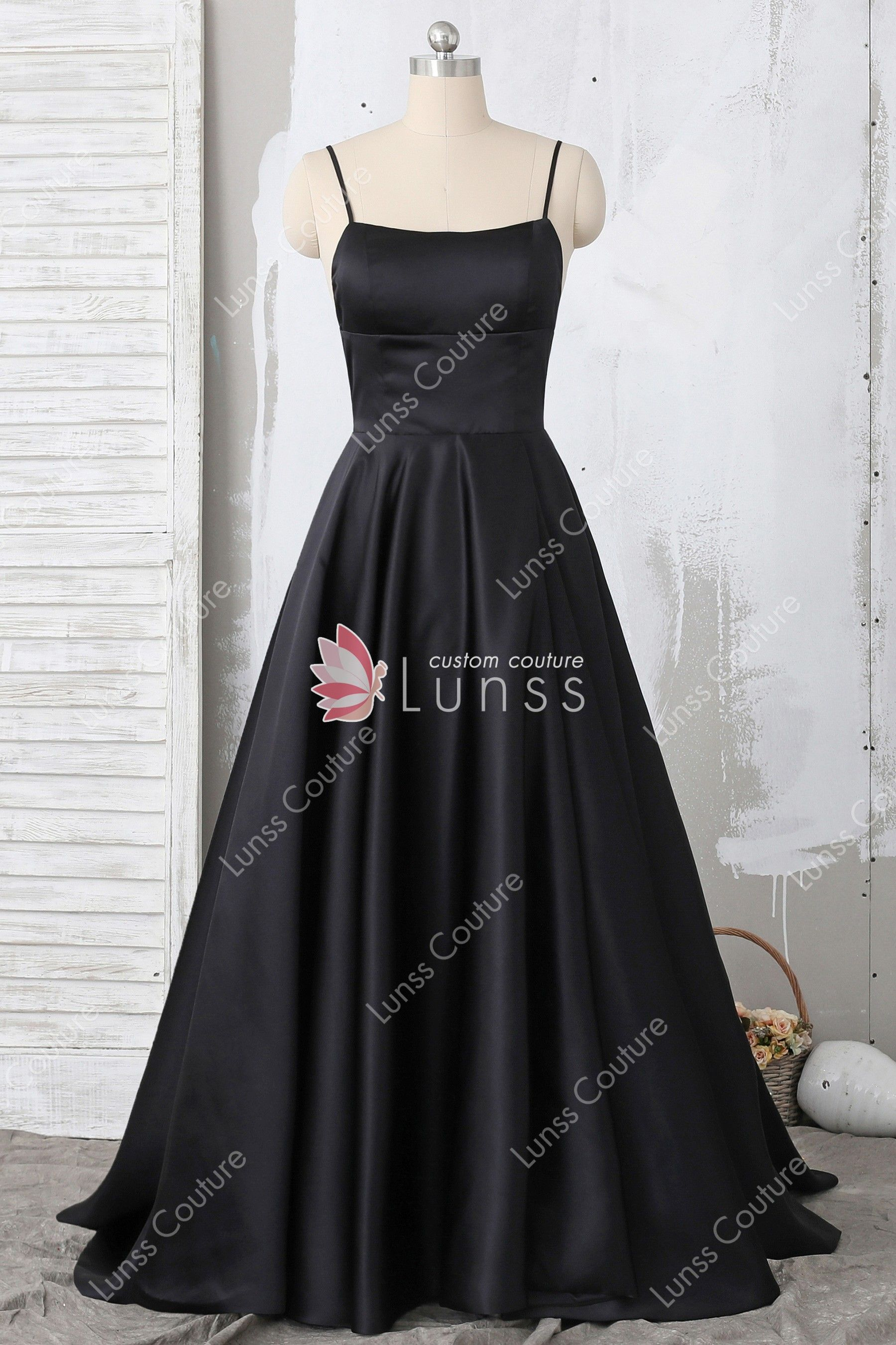 1ecab9262d8a This simple black A-line formal gown features spaghetti straps, straight  across neckline,