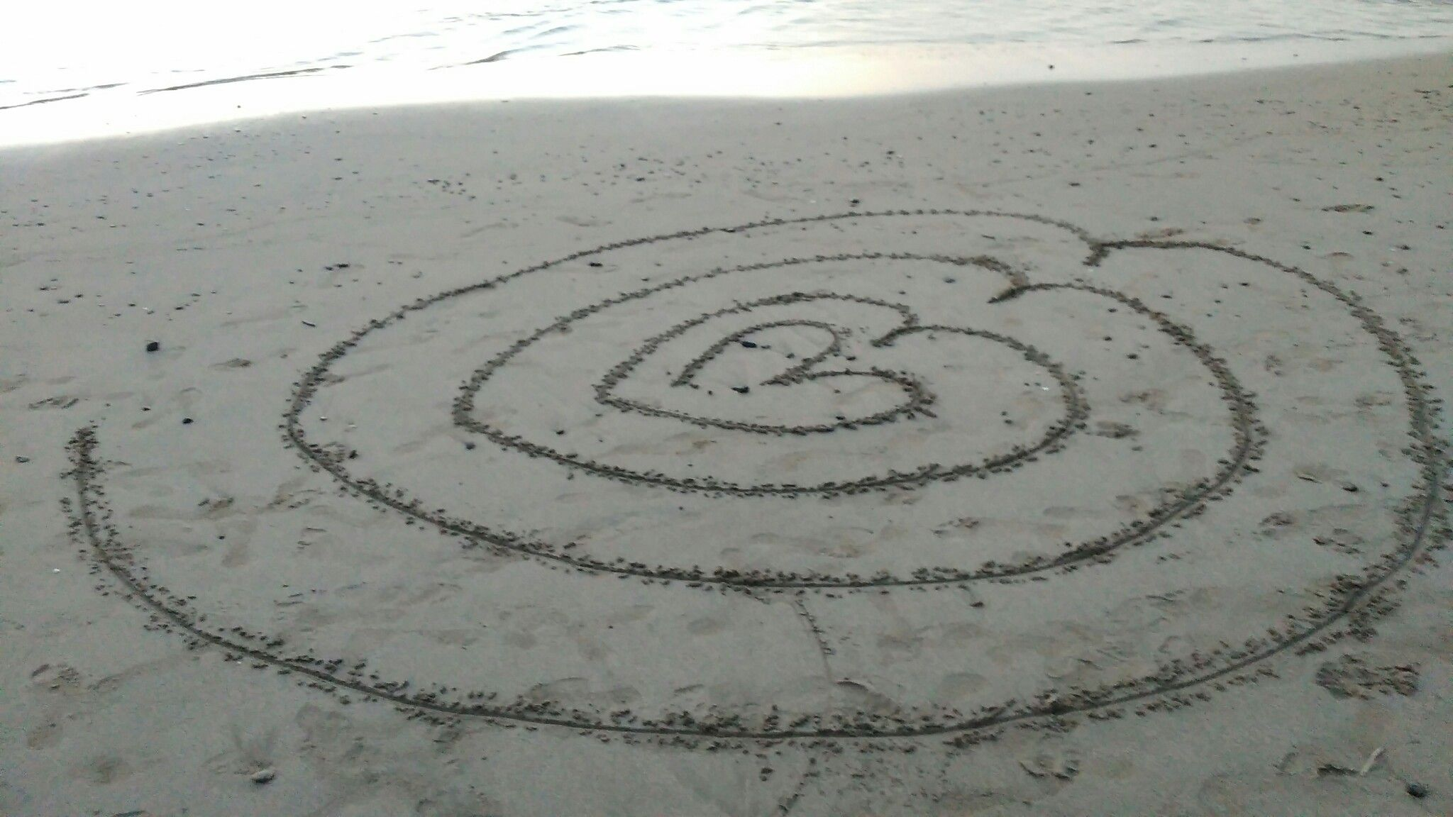 A heart labyrinth in sand. | Labyrinths | Pinterest