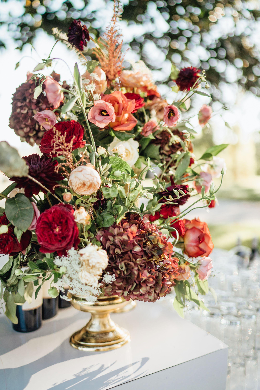 Floral arrangement // burgundy flowers // orange flowers