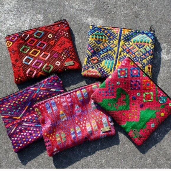 """*Coming soon*. Recycled textile make-up bags Ketzalu bags!   Each bag is 8"""" x 6.5""""   Material content: recycled textiles handmade in Guatemala. Each bag is one of a kind.                 Please comment below and I will create you a custom order. I will take pre-orders and hold the bag for you. I will notify you when it comes in! Ketzali Bags Cosmetic Bags & Cases"""