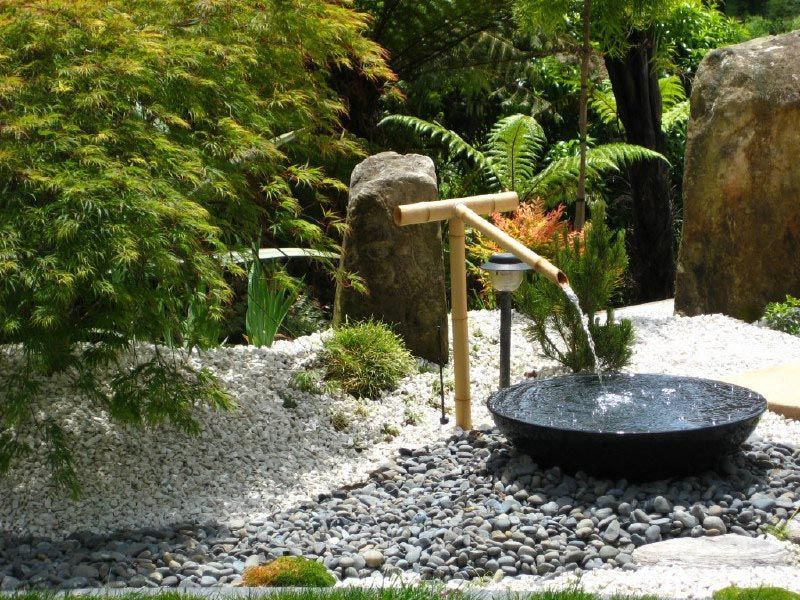 Water Fountain In A Contemporary Japanese Garden Design