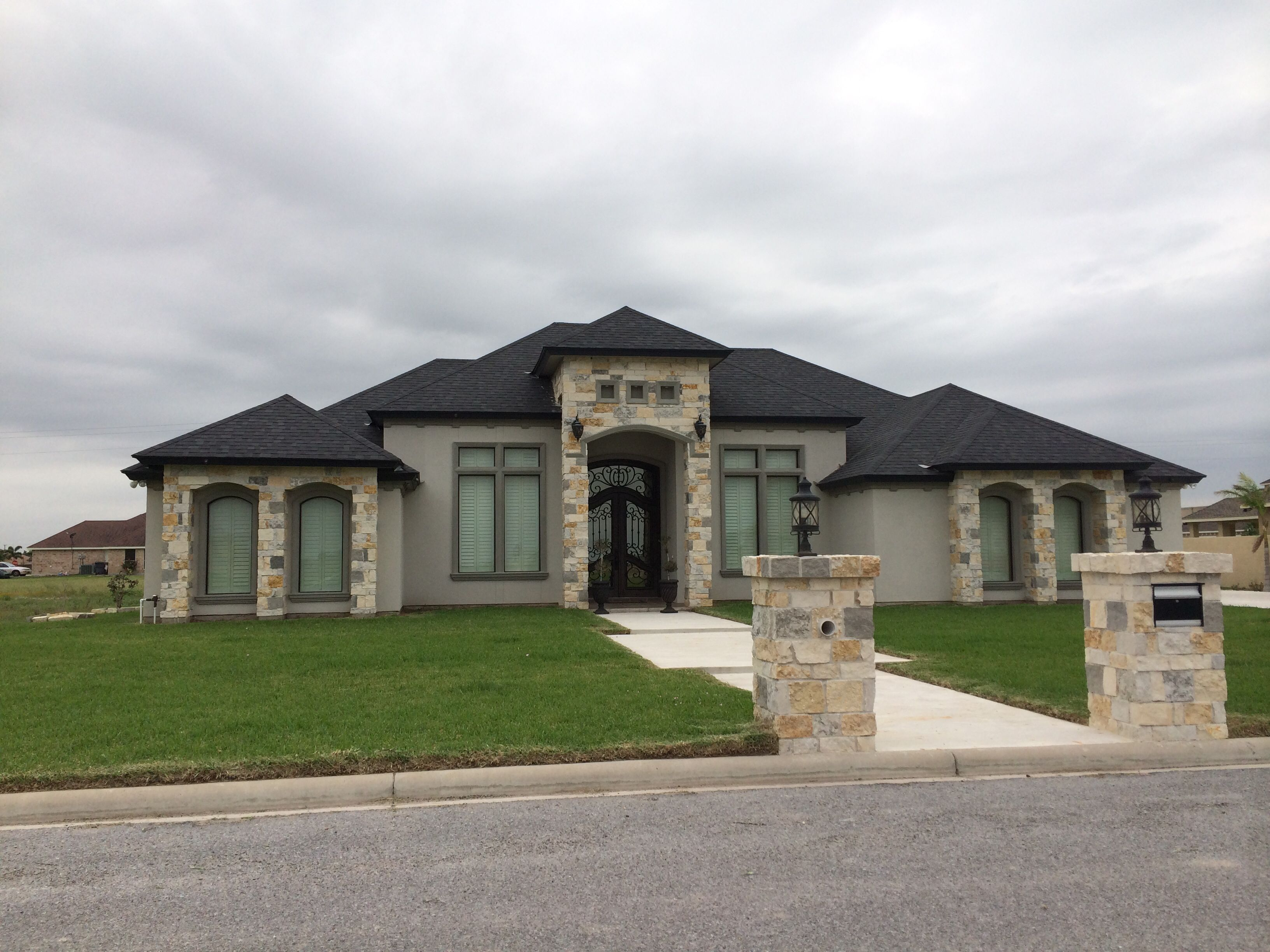 Really like the stone facade on this grey stucco home for Stucco facade