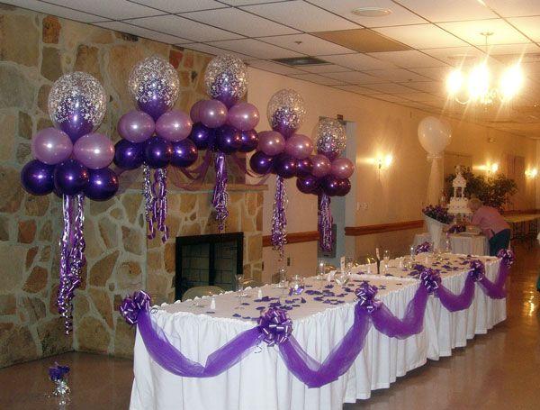 Purple balloon wedding arches decorated tan tuxedo