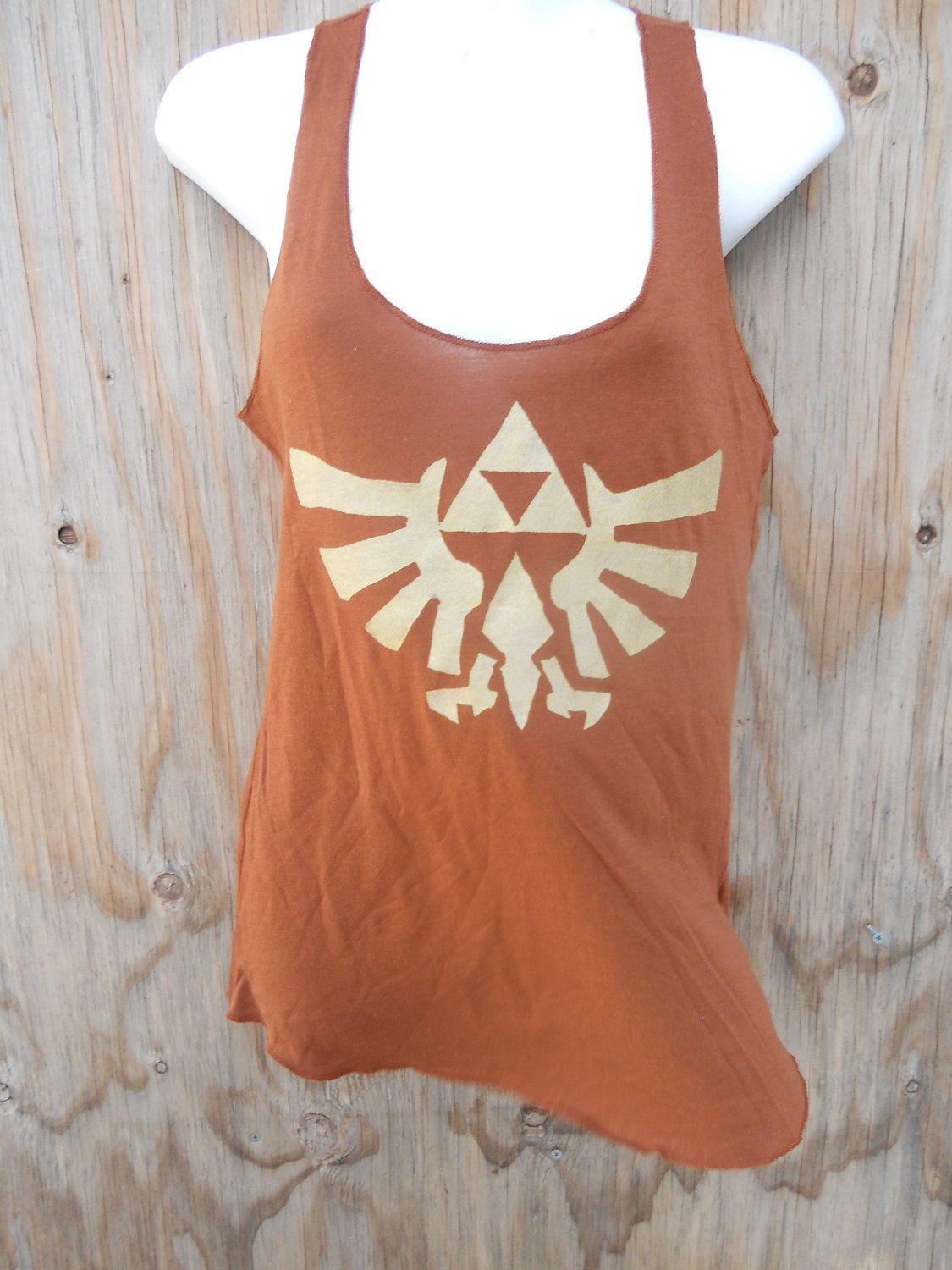 Brown Legend of Zelda Triforce Eagle Racerback tank top. $20.00, via Etsy.