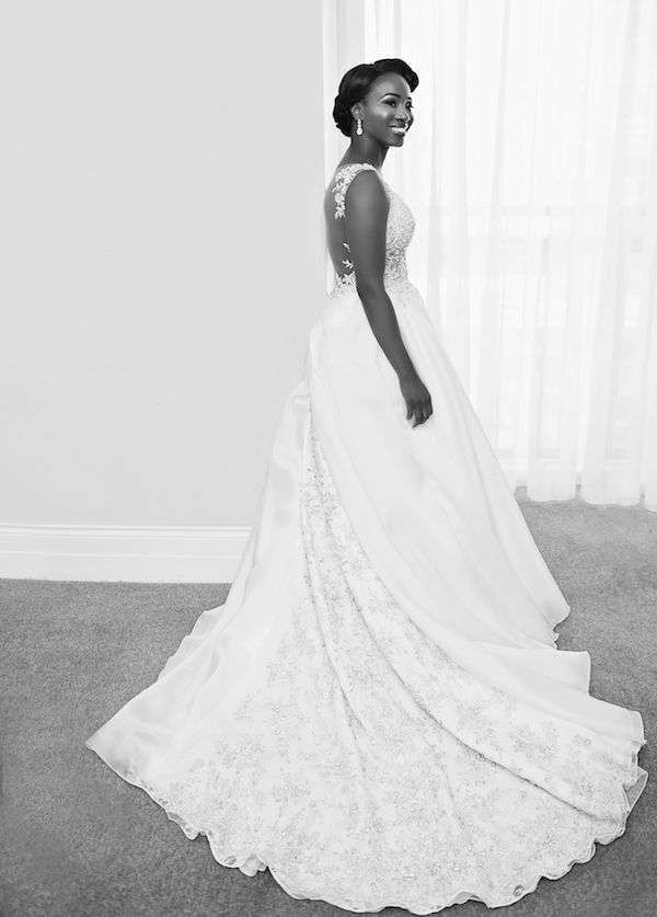 Ball Gown with Sparkling Train   Photography: Carasco Photography. Read More:  http://www.insideweddings.com/weddings/church-ceremony-with-nigerian-traditions-chic-ballroom-reception/845/
