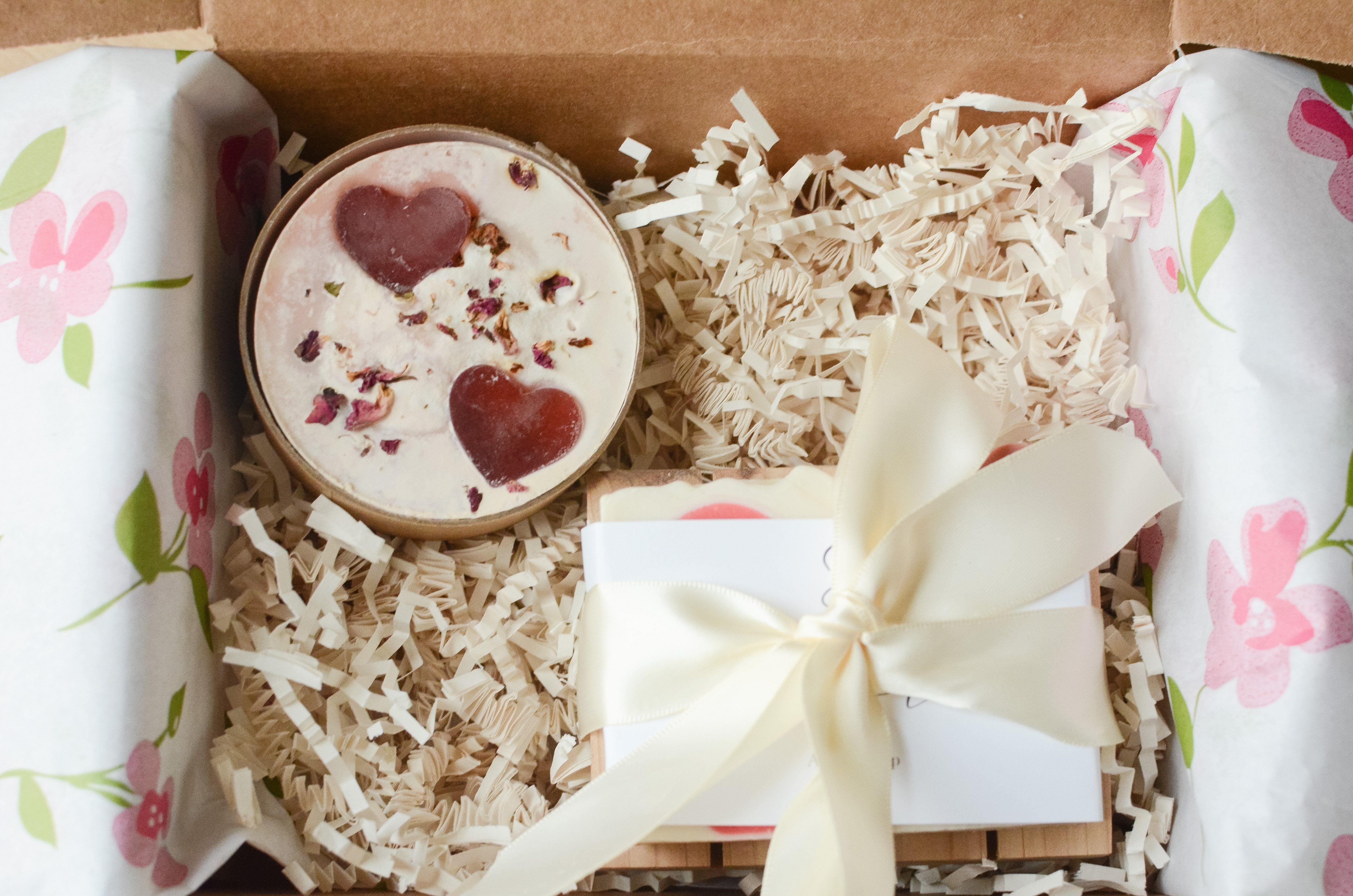 """Amore means love in Italian and is there a more perfect sentiment? These soaps are two Italian themed expressions of love. The first is """"Cuore"""" - which means """"heart"""" - it is an apple sage scented soap with two prominent hearts on a white background. It has the addition of Tussah silk for extra slip and luxury. The round soap is """"Tesoro"""" which means """"Treasure"""". This bar has shea butter and rose clay. It's scented with peony fragrance oil. It has glycerin soap heart embeds and red rose petals. It"""