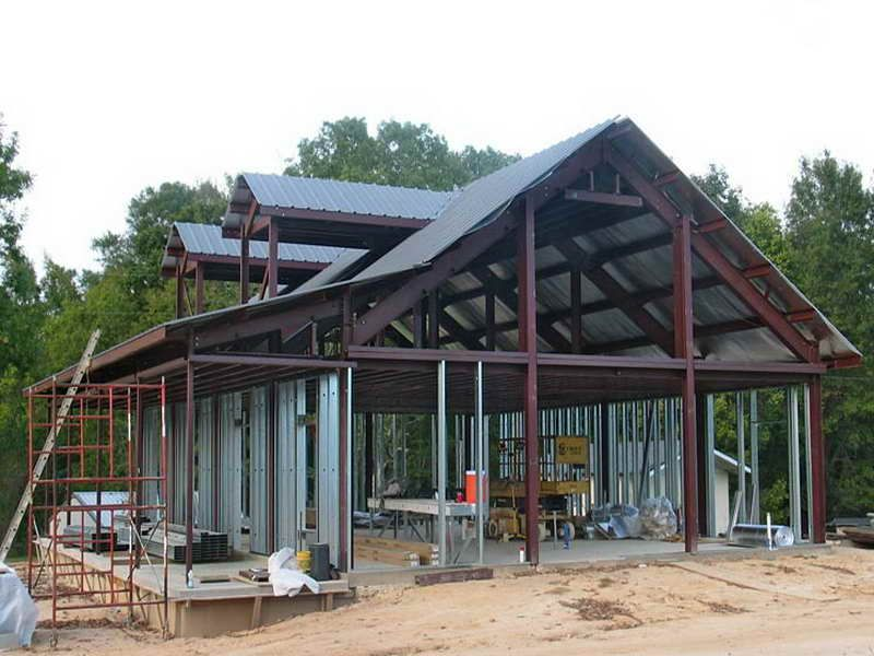 Metal building home ideas with red paint frame start for Steel frame cabin