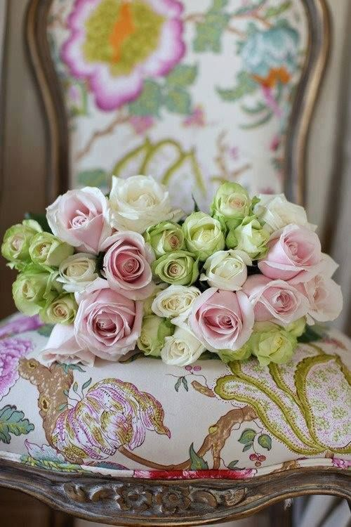 Still life of roses and elegant chair.