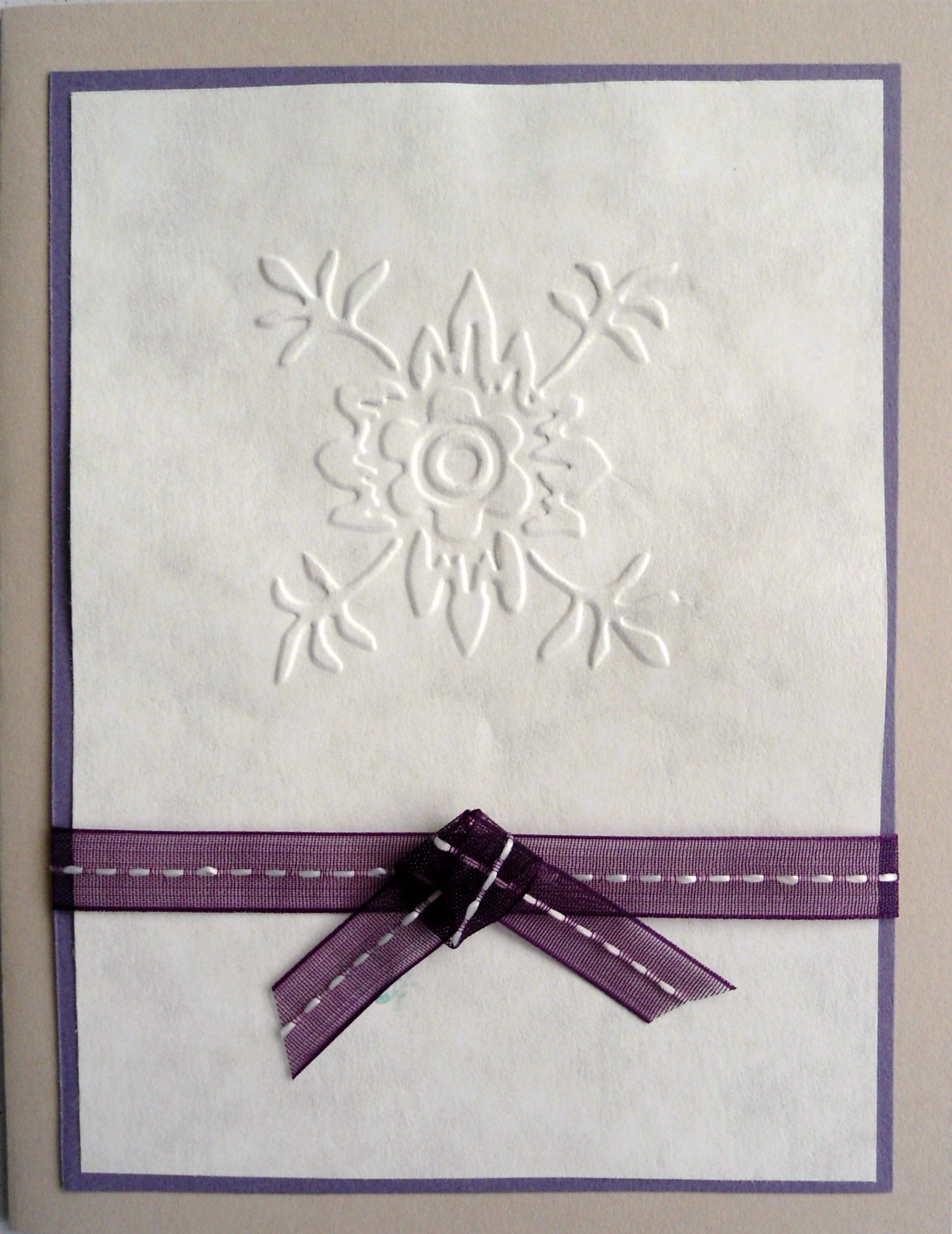 I embossed the image on a piece of paper, backed it with lavender and wrapped a purple ribbon around it; affixed it to the card: done...