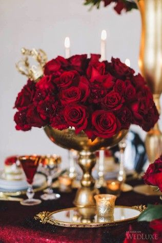 Luxury wedding centerpiece: classic red roses in a tall gold vase ...