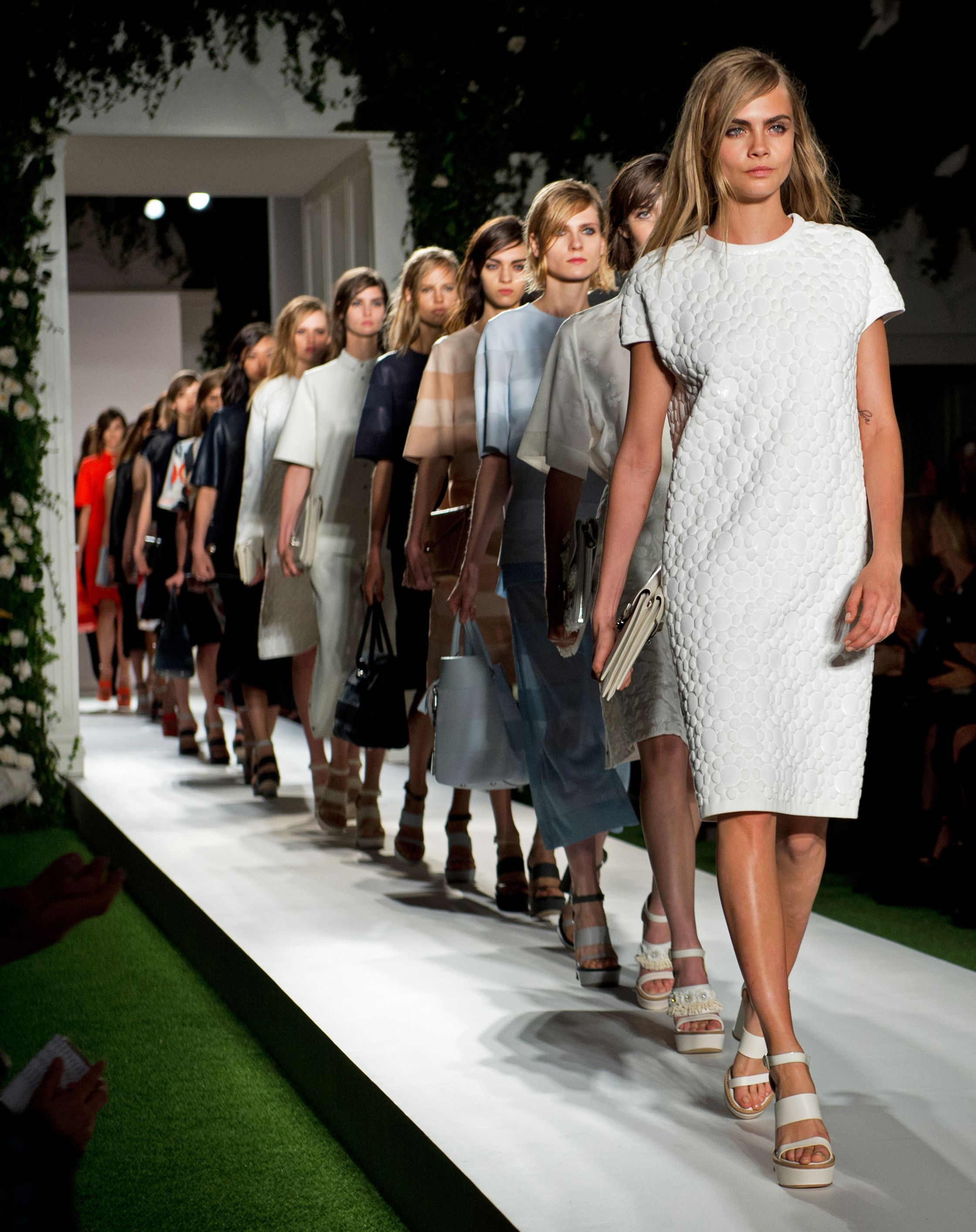 f9d11a6768 Cara Delevingne leads the final walk on the Mulberry catwalk for the SS14  show at London Fashion Week.