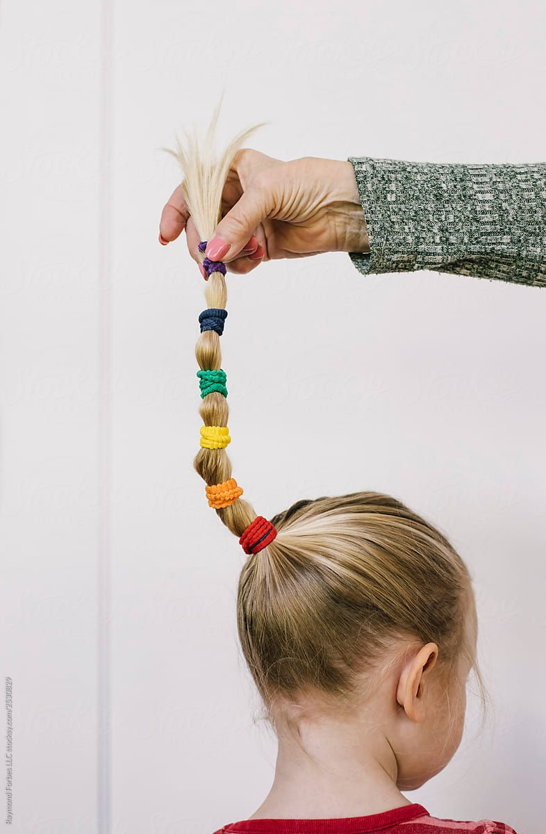 96bf1723ab0c4 Hand Holding Rainbow Braid On Young Girl | Stocksy United by Raymond ...