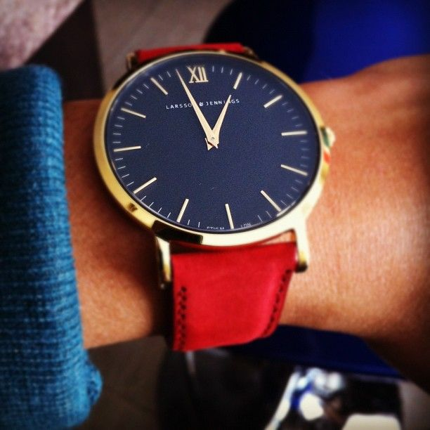 "Red ""Resurgence"" strap with black/gold watch face. Absolutely divine. #larssonjennings"