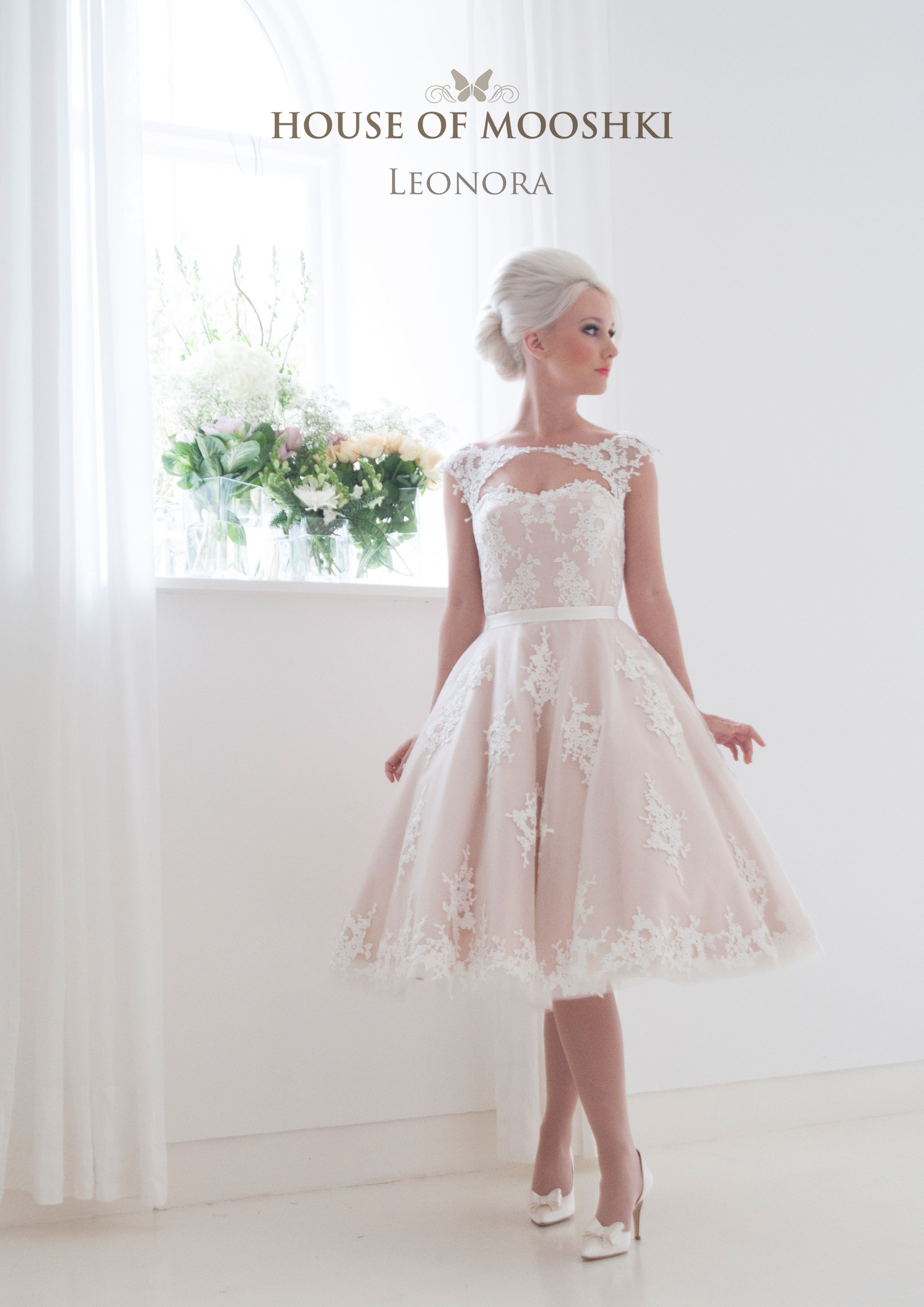 Soft blush satin overlaid in ivory tulle and lace a sweet diamond