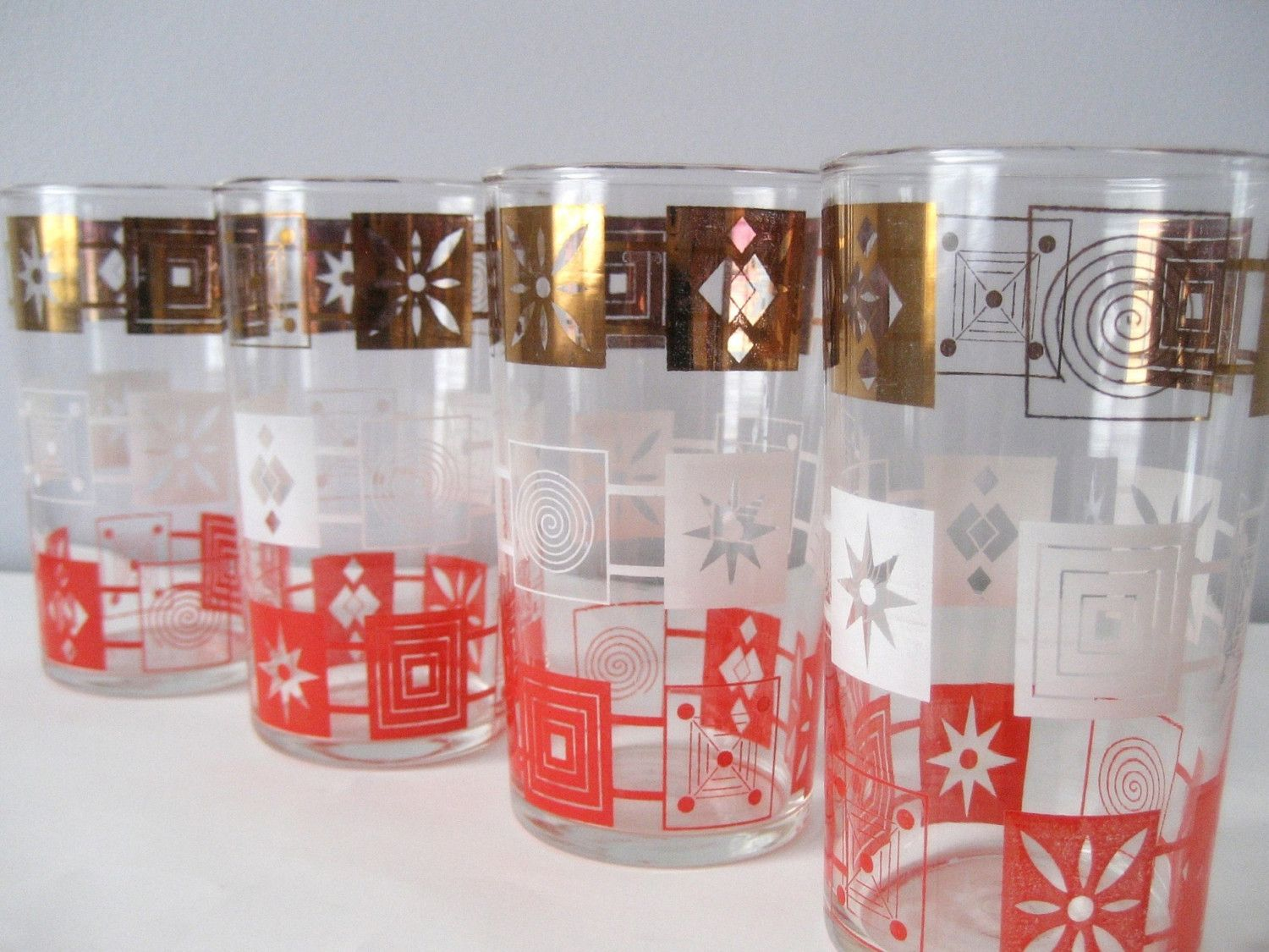 Vintage 1950s 50s Kitsch Kitschy Drinkware Drinking Glasses Cups Set of 4. $20.00, via Etsy.