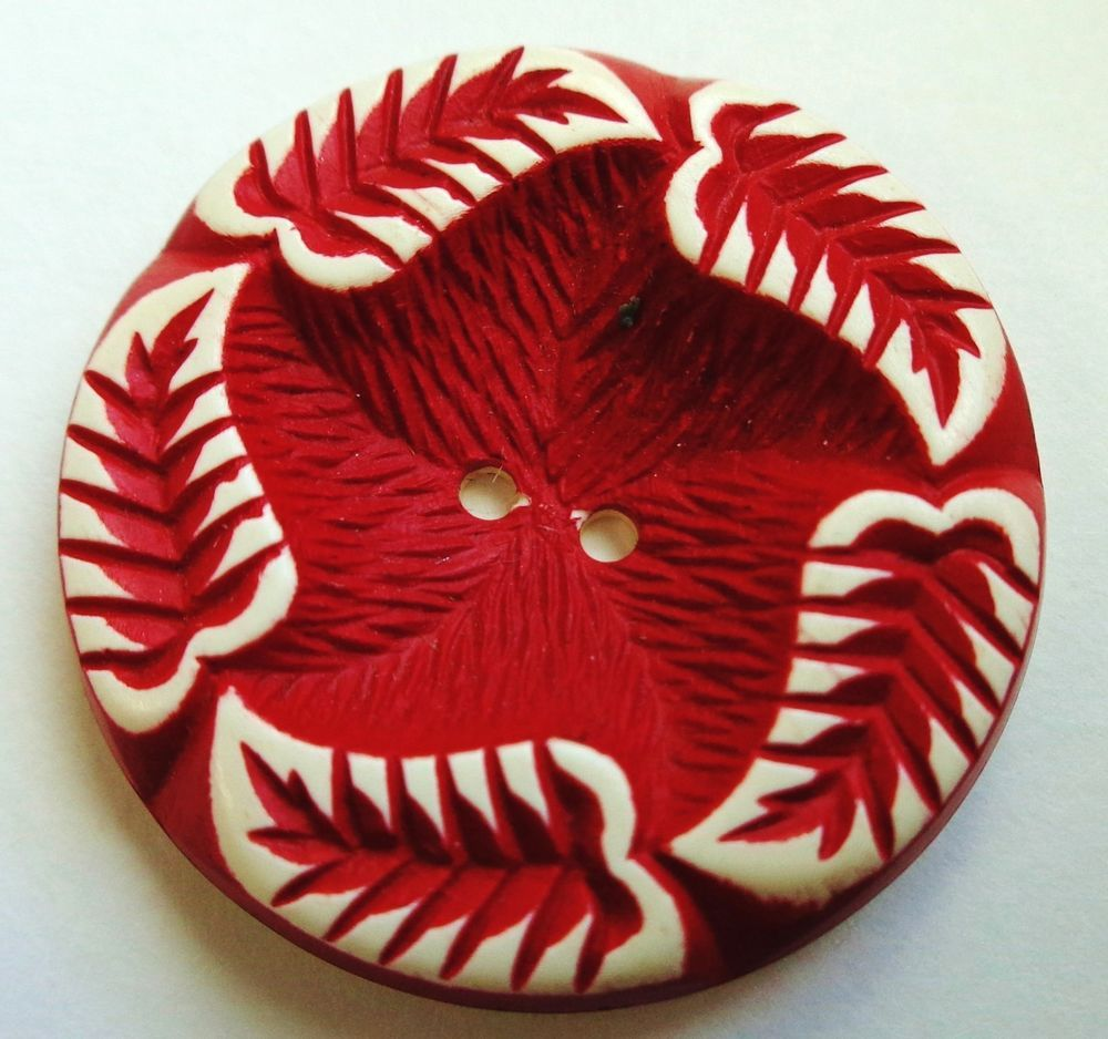 VINTAGE RED & WHITE  BUFFED CELLULOID BUTTON   LEAVES  1""