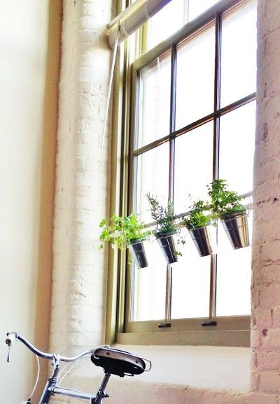 Tension Rod Uses.  A pretty touch for a sunny window! A super simple herb garden using a tension rod and some IKEA buckets and clips.