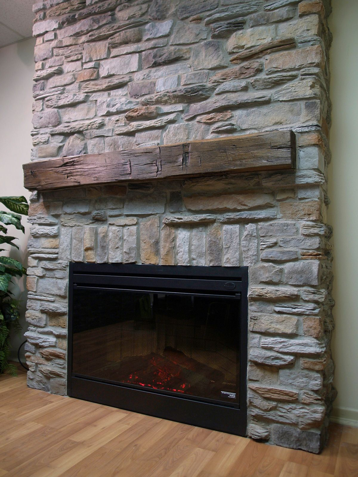 decoration stone veneer stack on fireplace with electric fireplace also on wooden flooring tile