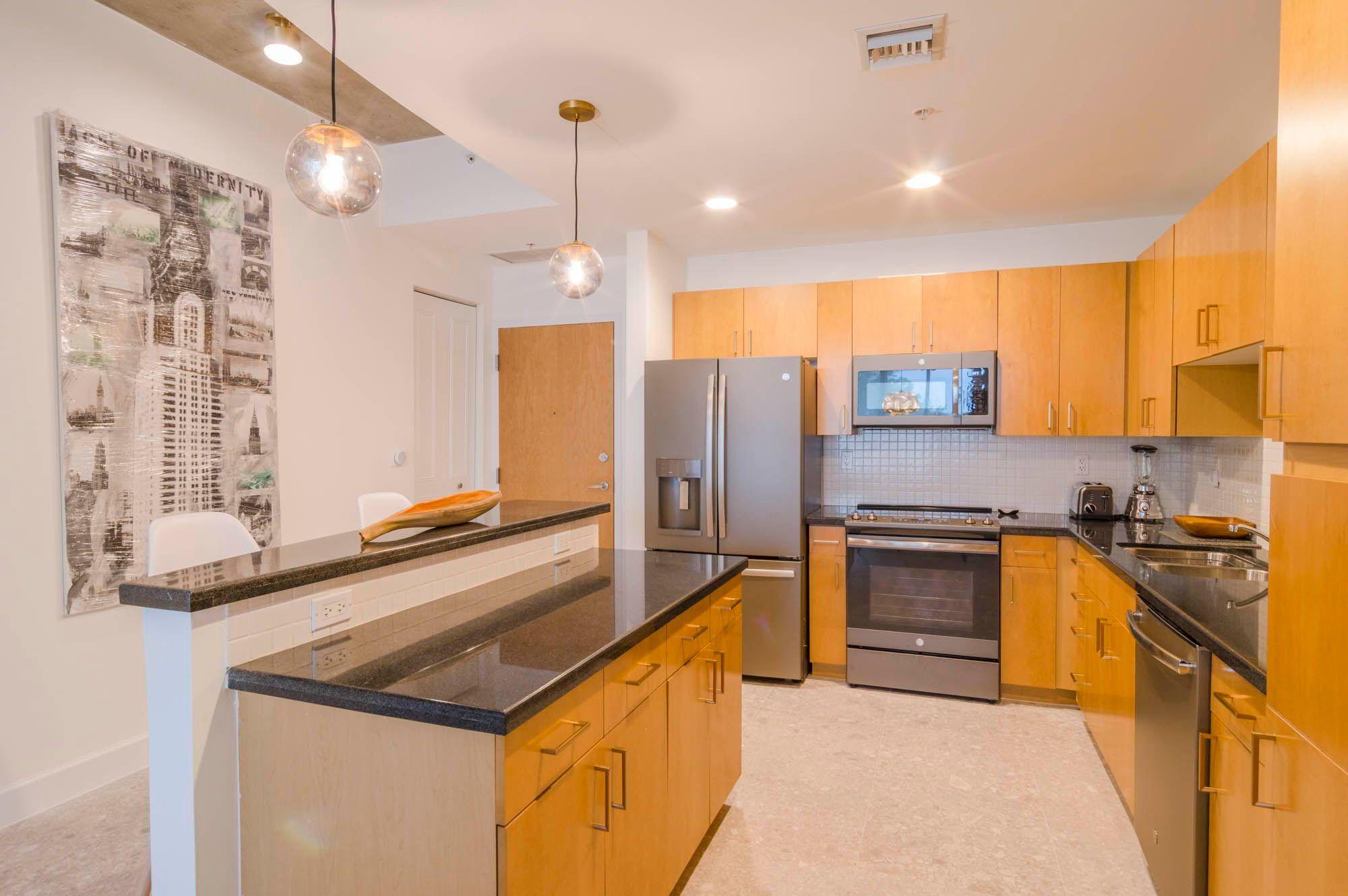 300 S Australian Avenue 210 West Palm Beach Fl Light Oak Cabinets Modern Light Fixtures West Palm Beach
