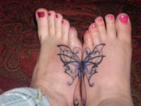 this is kinda what I thought we should get. not the butterfly but something thats whole when we put our feet together