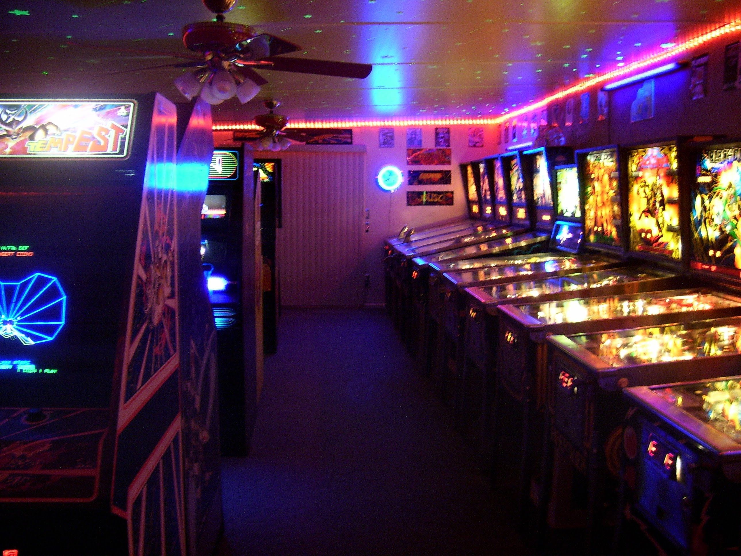 A RECREATION OF THE 80S ARCADE GAME ROOM INCLUDES PINBALL VIDEO GAMES LASER DISK SHUFFLE BOWLER AND MORE 15 YEARS TO COMPL