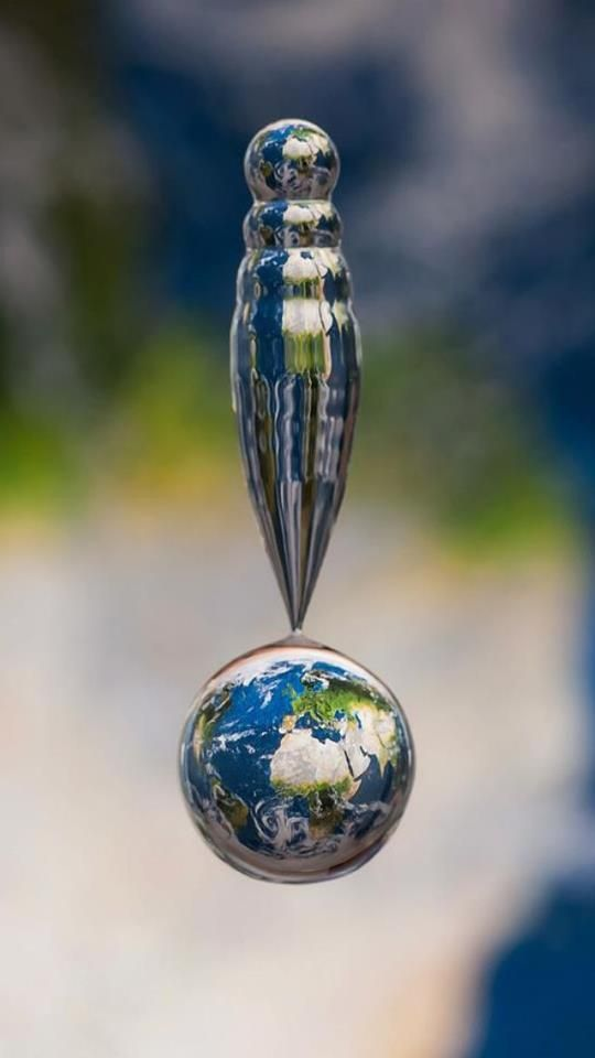 Good morning. Check out this photo of a water droplet, shot over a map. Pretty amazing.