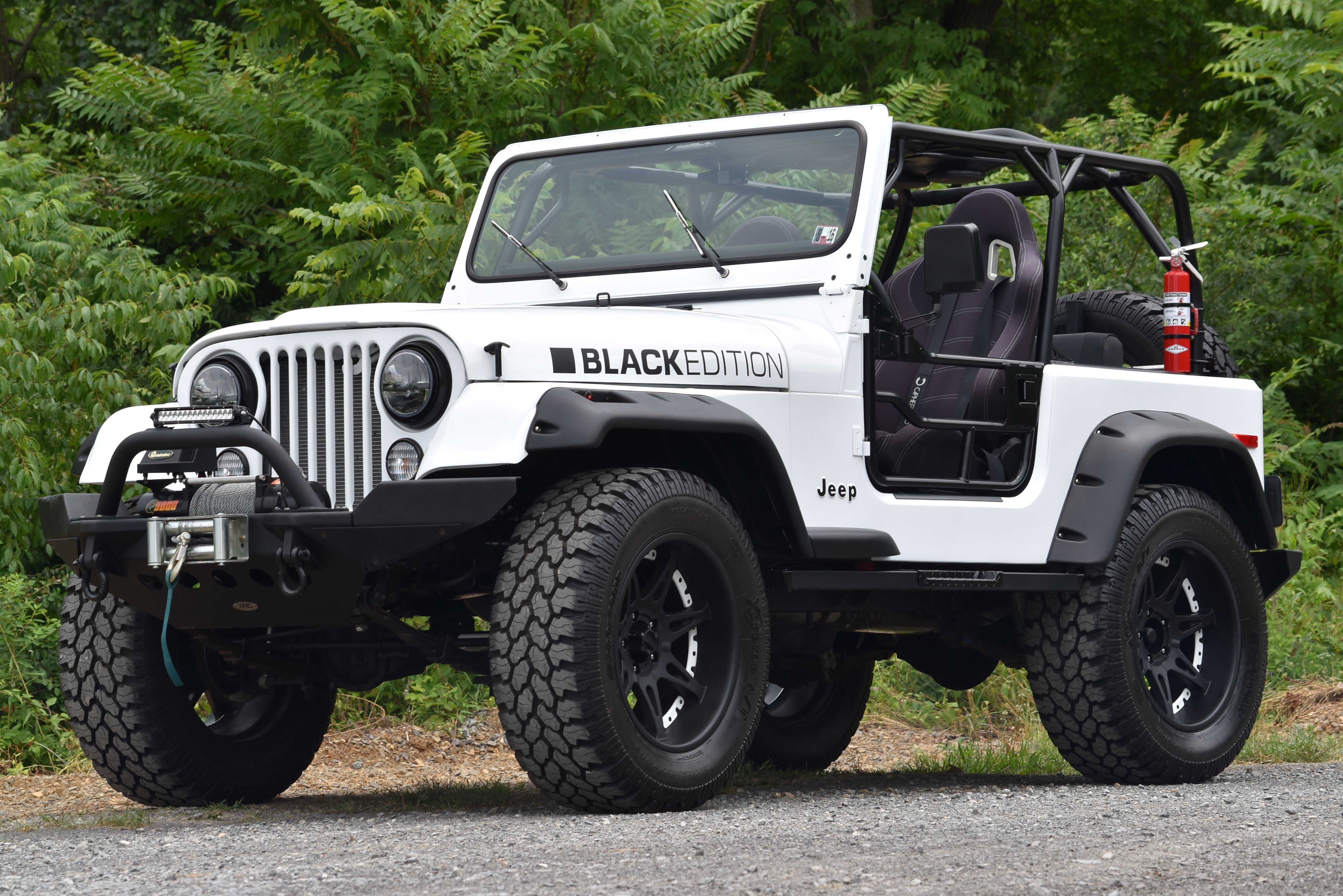 this beautifully restored black edition 1980 jeep cj 7 has been a complete frame off build and features a 347 c i ford v8 motor fully custom roll cage  [ 4496 x 3000 Pixel ]