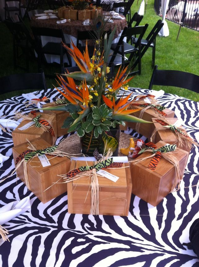 Safari table decoration with a jungle theme zebra print for African party decoration