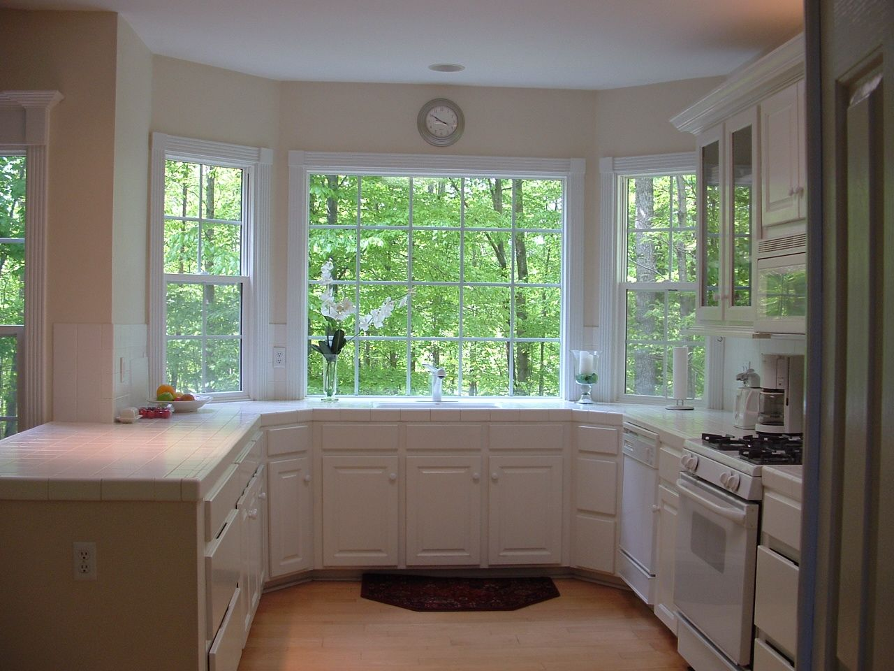 This was our all white kitchen in Virginia The Maple floors warmed