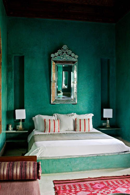 My dream bedroom. From hotel El Fenn in Marrakech Morocco. The emerald - turquoise palette with red and coral accents is so beautiful. Love the oriental mirror and otherwise simple decor that lets the colours do the talking.