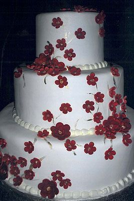 More red and white add black piping for jessica or ribbon fancy red with white flowers wedding cake mightylinksfo Image collections