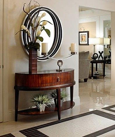Curved Entry Table And Contrasting Metallic Mirror Is A Subtle Nod To Deco.