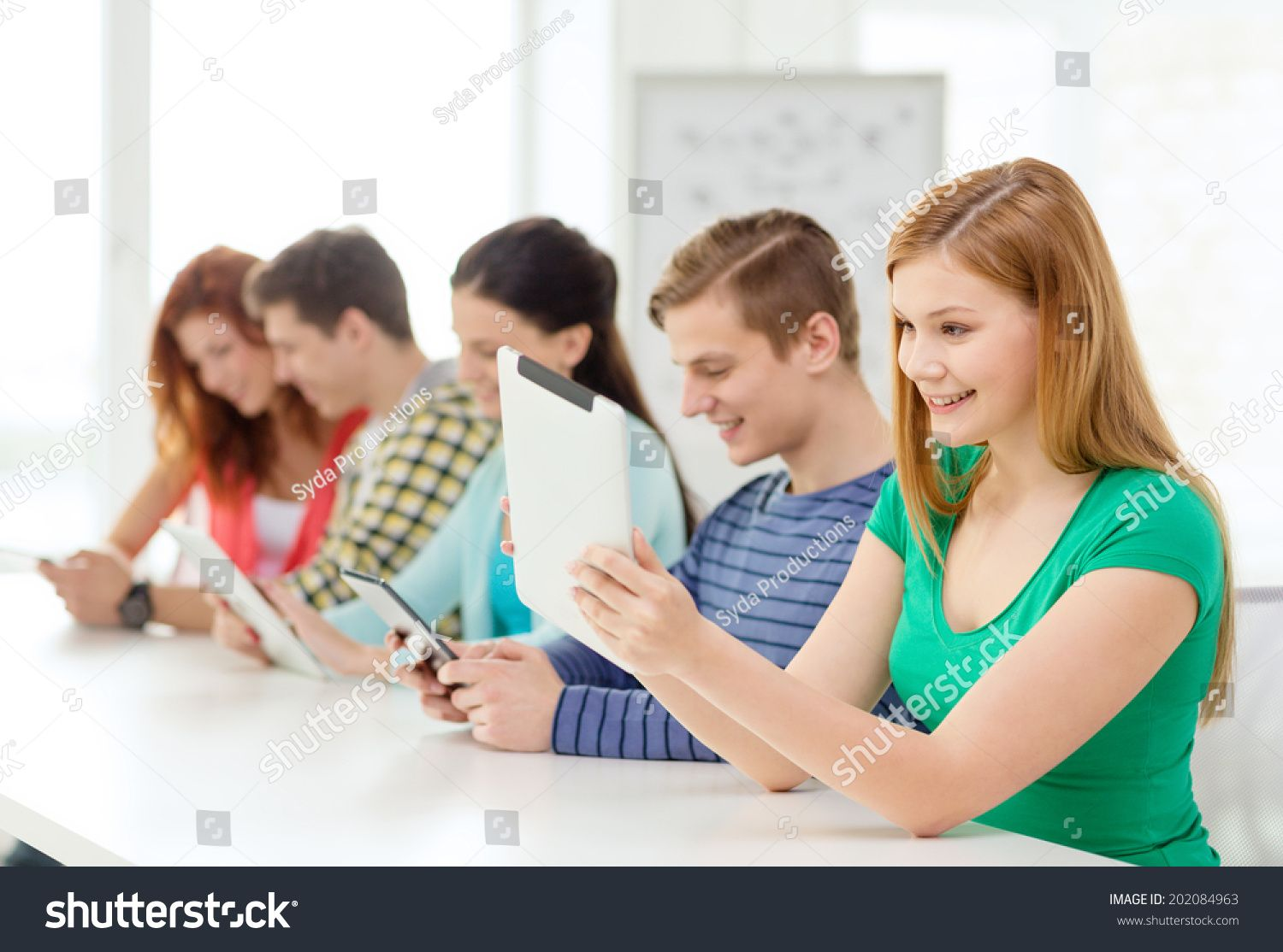 education, technology and internet concept - smiling students with tablet pc computers at school #Ad , #AFFILIATE, #concept#smiling#internet#education