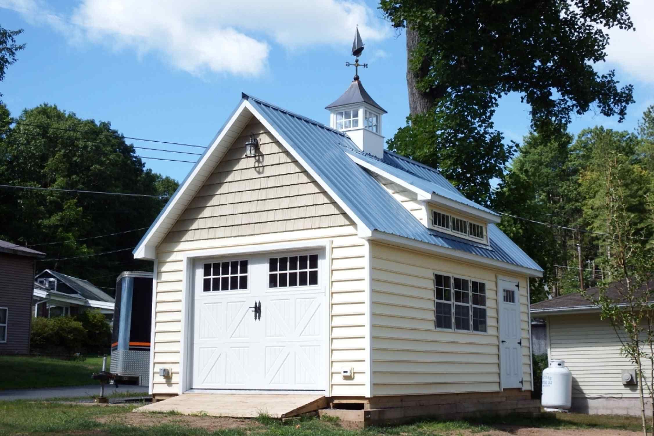 14x20 Colonial Barn, Vinyl siding, Metal roof, 3 transom dormer