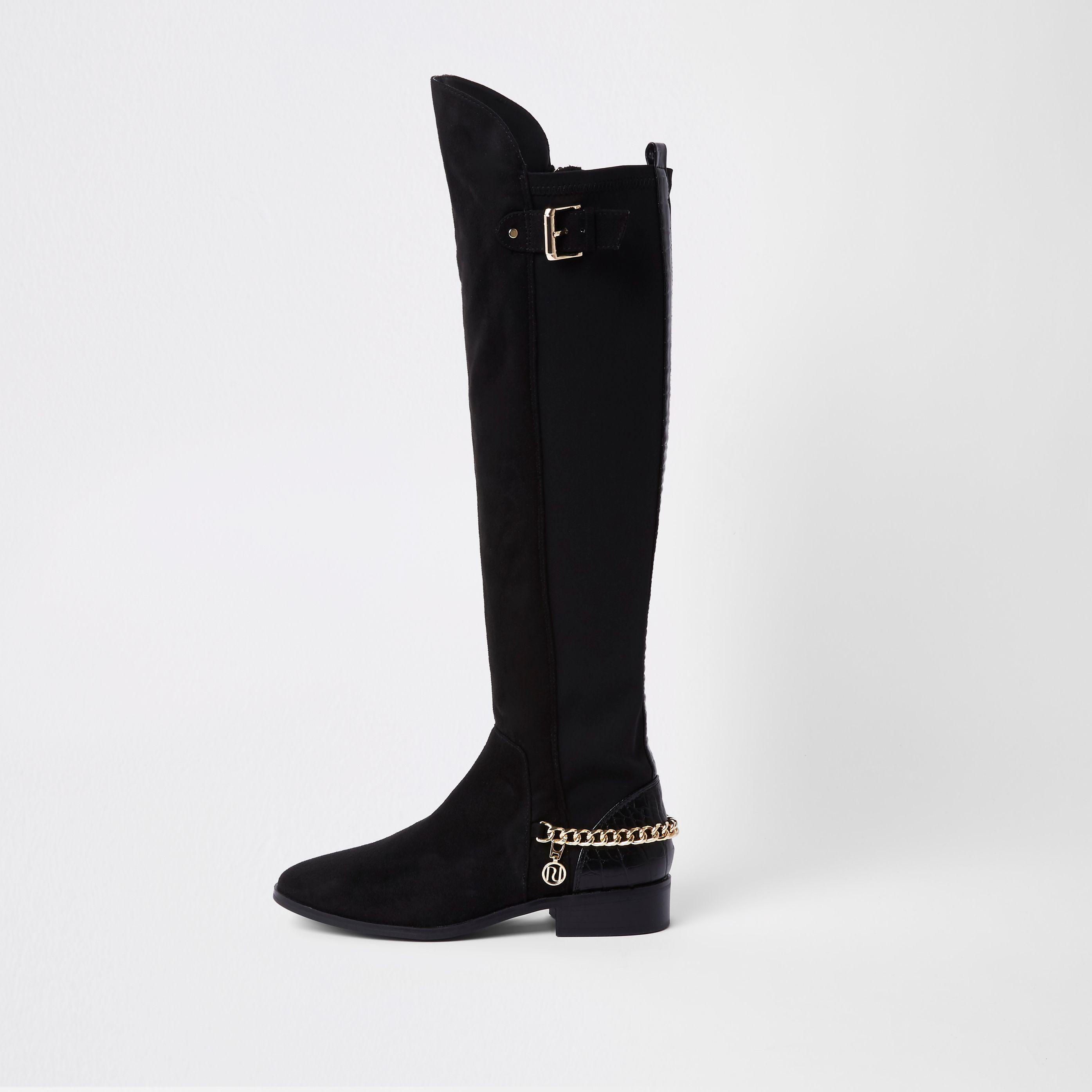 Black chain detail knee high boots