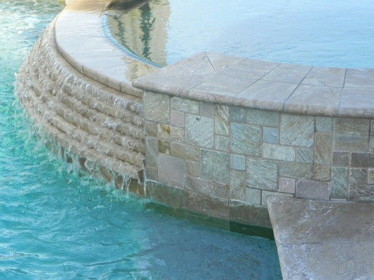 Coping, spillway,  and tile with blue on spa face