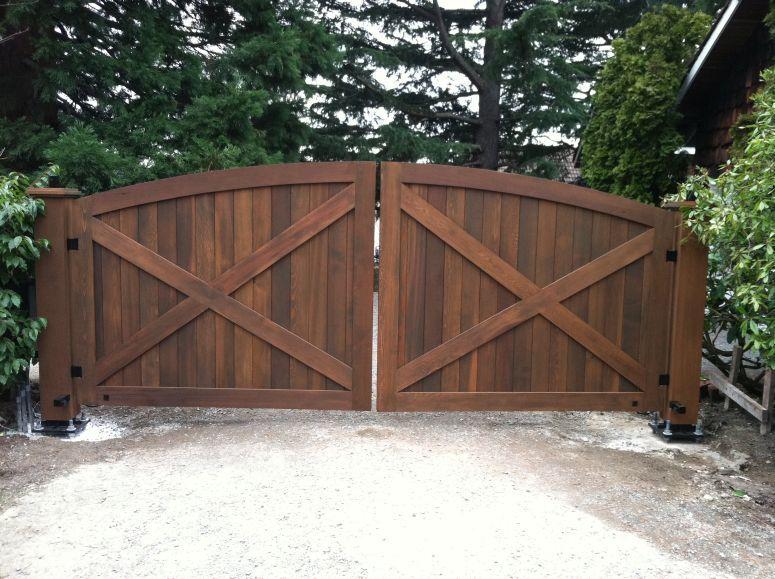 Beautiful wood gate with barn style doors iron