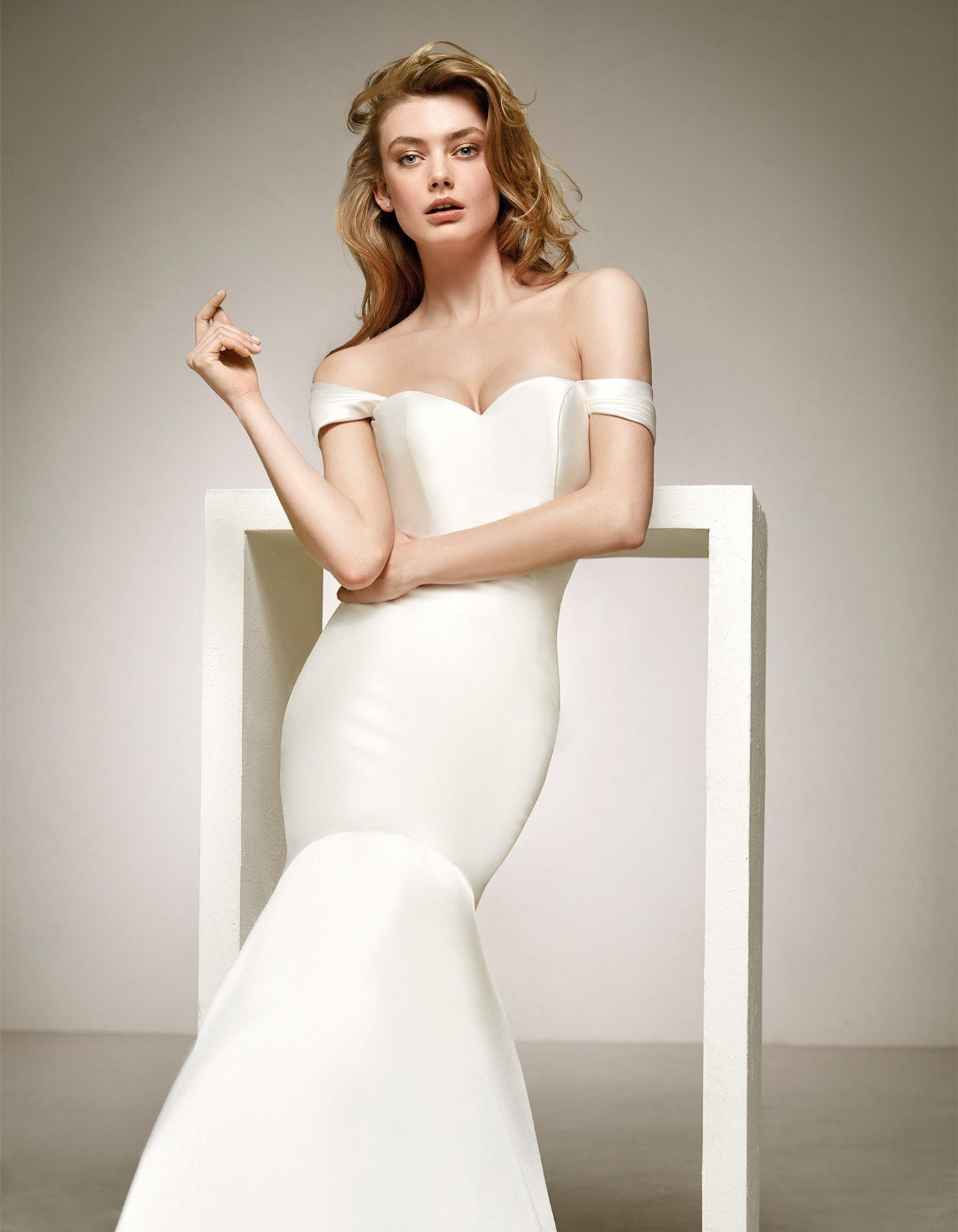 Delco by Pronovias A sensual design that showcases curves and the feminine  silhouette. A mermaid wedding dress with a sweetheart neckline and ... 6a164992c03