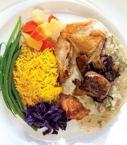 The plump roasted chicken & rich truffled mushroom sauce at Chez Leon is an SLM favorite. Photo credit: JENN SILVERBERG. BEST DISHES, FEBRUARY 2012 ISSUE, PAGE 75.