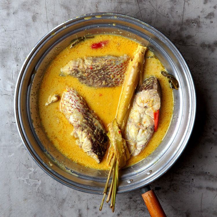 For this aromatic nasi padang dish, red snapper is simmered in a spicy coconut curry.