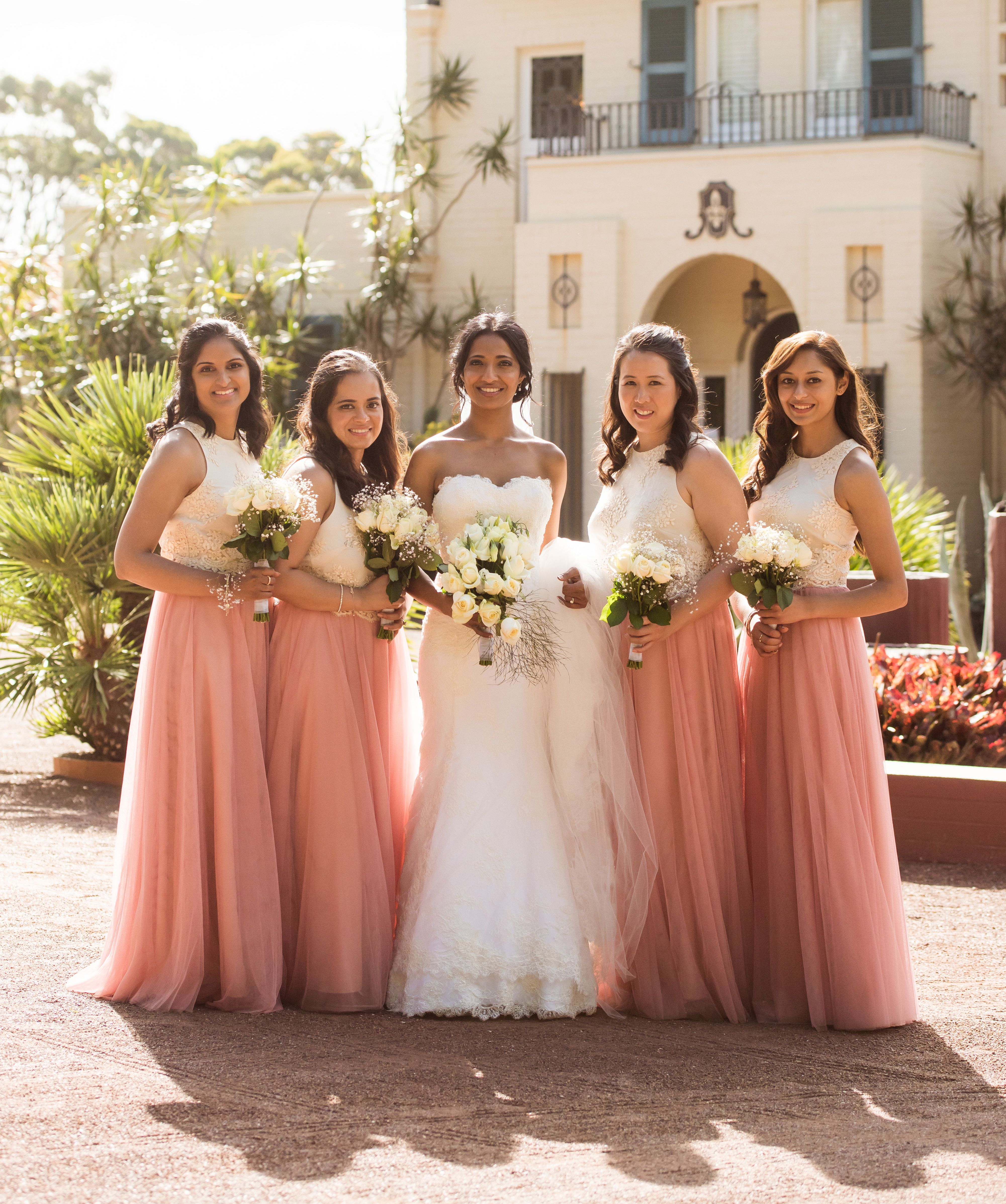 f1608d13c2 Mix and match bridesmaids outfit with blush pink tulle maxi skirt and lace  ivory crop top