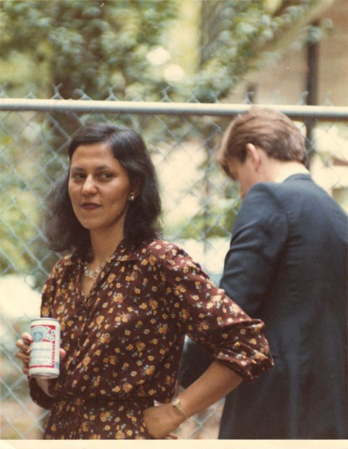 This is a photo of my mother, Bonnie Sterritt, in the summer of 1981.  Born in Burma, and then raised in England, she moved to America with my father a year or two before this photo was taken at an outdoor wedding reception in Aiken, South Carolina.  I love my fashionable brown mother, unable to hide her feelings about the Budweiser in her hand.  Submitted by Merrill Sterritt (Brooklyn, NY).