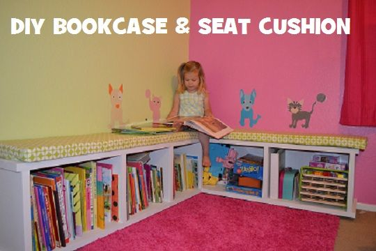 DIY bookcase & seat cushion we made for our playroom library - based on IKEA Expedit shelves on sides idea - so much cheaper to make your own!